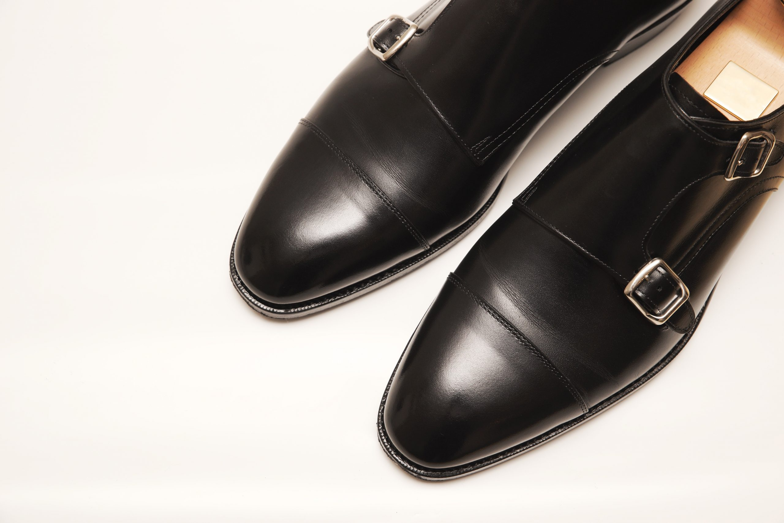 Black,Leather,Shoes,Photographed,On,A,White,Background.